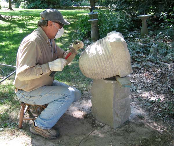 Ed Januska carving a bee skep